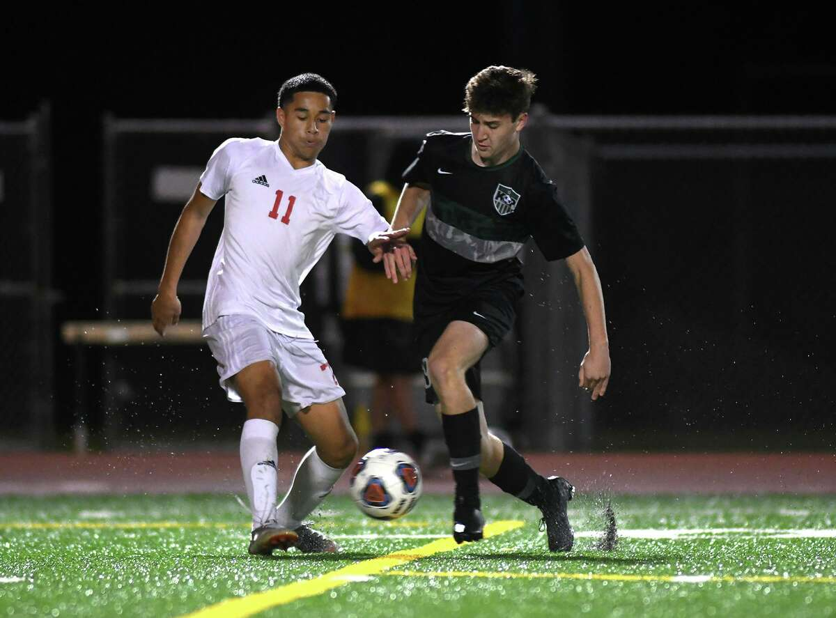 Kingwood Park junior midfielder Nathan Jimerson, right, works the ball against Tomball sophomore defender Kevin Borja (11) during their District 20-5A matchup at KPHS on Jan. 28, 2020.