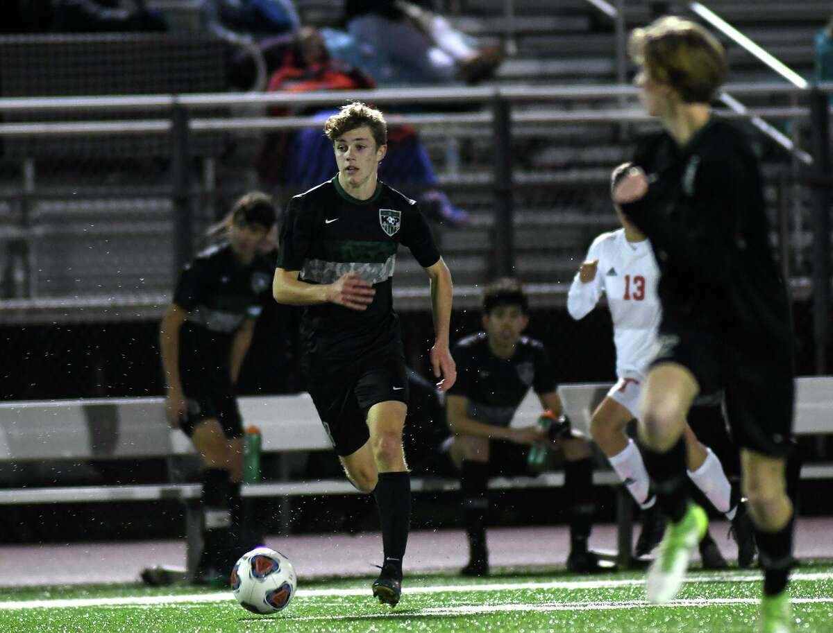 Kingwood Park junior midfielder Nathan Jimerson, left, works the ball upfield against Tomball during their District 20-5A matchup at KPHS on Jan. 28, 2020.