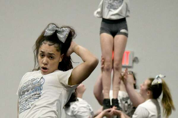 Members of the Premier Cheer Athletics, including Miranda Diaz (center) practice their routine on Thursday, Feb. 20, 2020, at their Watervliet gym. They captured first place in a New Jersey cheerleading tournament and qualified for the D2 Summit in May at Walt Disney World in Orlando. (Joyce Bassett / Special to the Times Union)