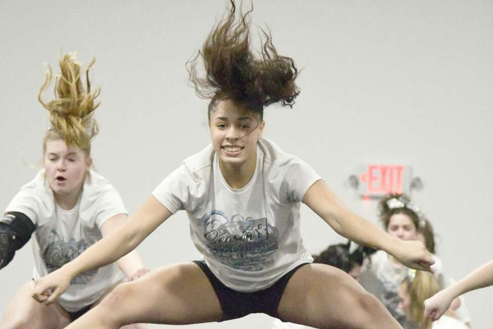 Members of the Premier Cheer Athletics, including Miranda Diaz (center), and Mikayla Joslyn, practice their routine on Thursday, Feb. 20, 2020, at their Watervliet gym. They captured first place in a New Jersey cheerleading tournament and qualified for the D2 Summit in May at Walt Disney World in Orlando.  (Joyce Bassett / Special to the Times Union)