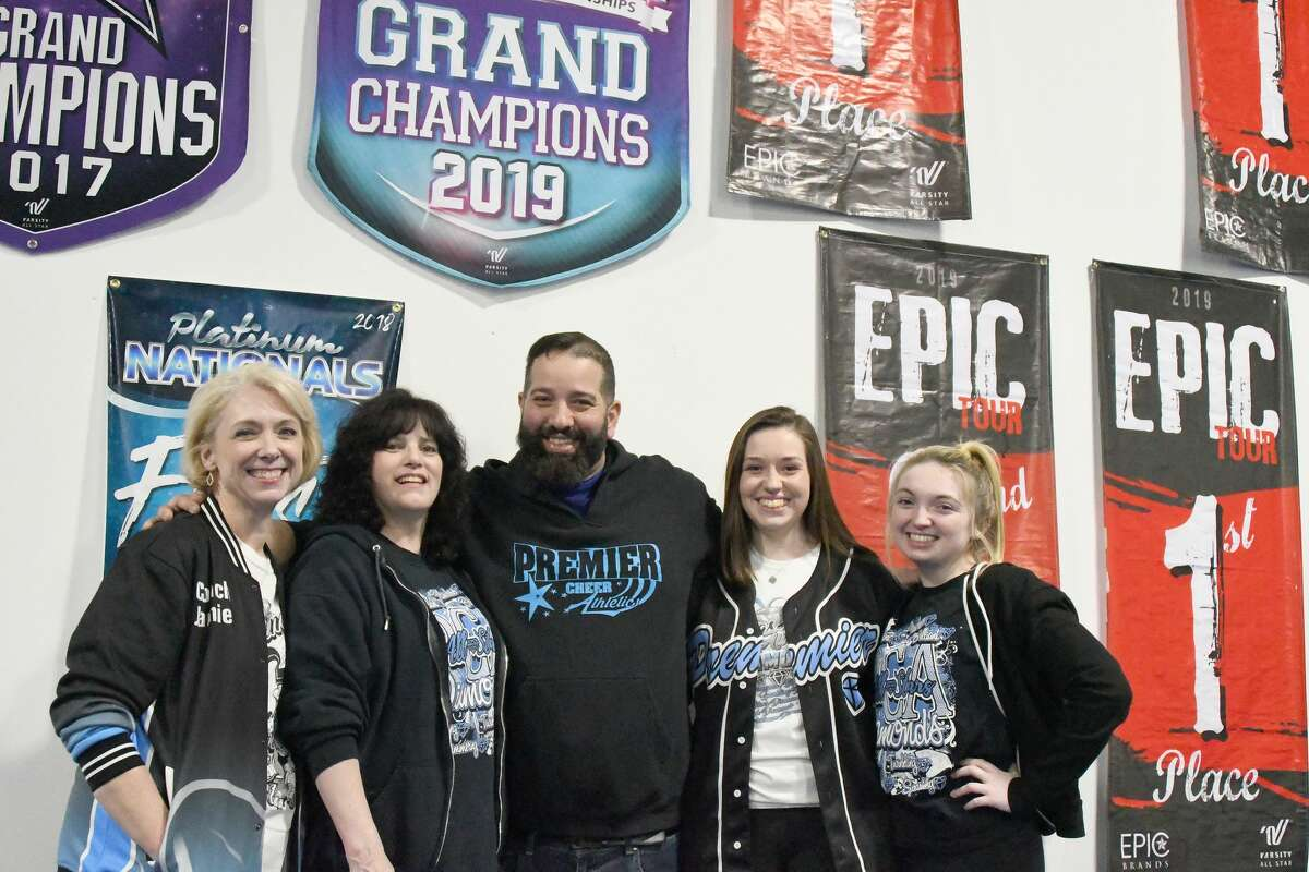 Premier Cheer Athletics coaches are, from left, Jamie Harrigan, Mary Landor, John Zapater, Kyleigh Belonga and Katie Harrigan. Zapater is a coaching consultant based in the New York / New Jersey area. (Joyce Bassett / Times Union)