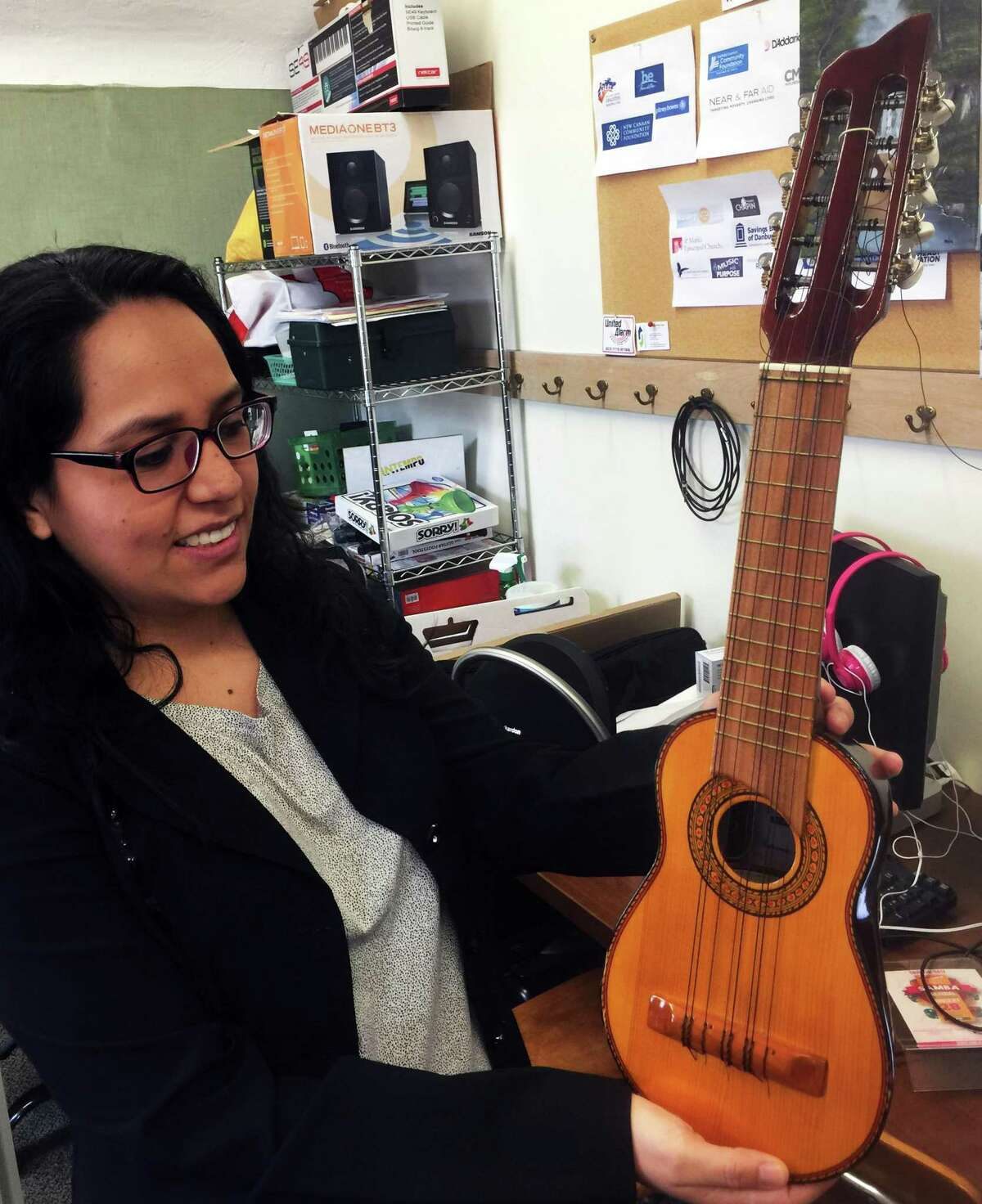 Angelica Durrell, founder of INTEMPO, holds a charango at the agency's base in Union Memorial Church on Thursday, Feb. 20, 2020.