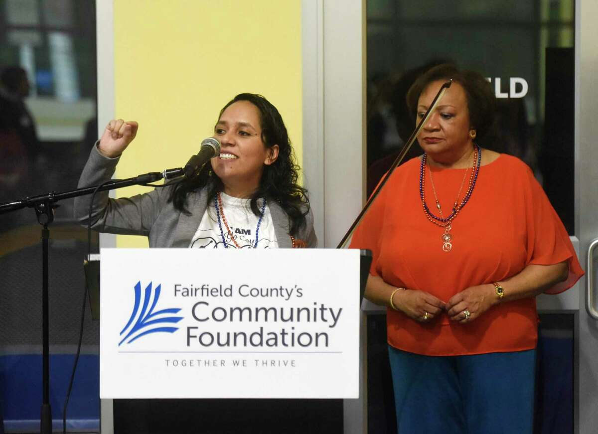 Angie Durrell, left, speaks beside Fairfield County's Community Foundation President and CEO Juanita James at the kickoff for Fairfield County's Giving Day at Chelsea Piers in Stamford, Conn. Thursday, March 1, 2018.