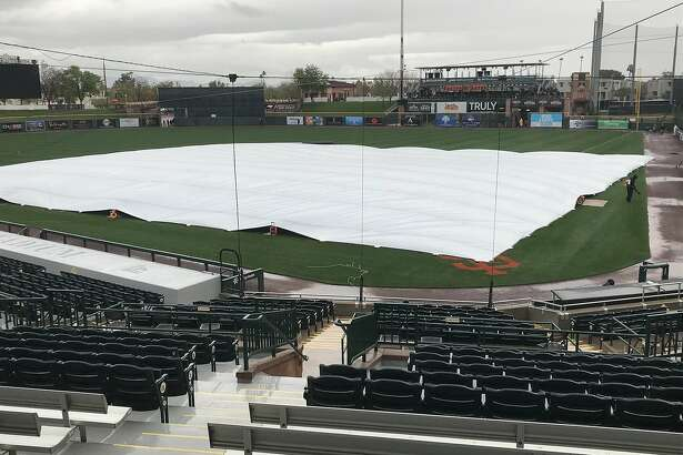 Rain falls on Scottsdale Stadium a few hours before the Giants' scheduled Cactus League opener against the Dodgers.