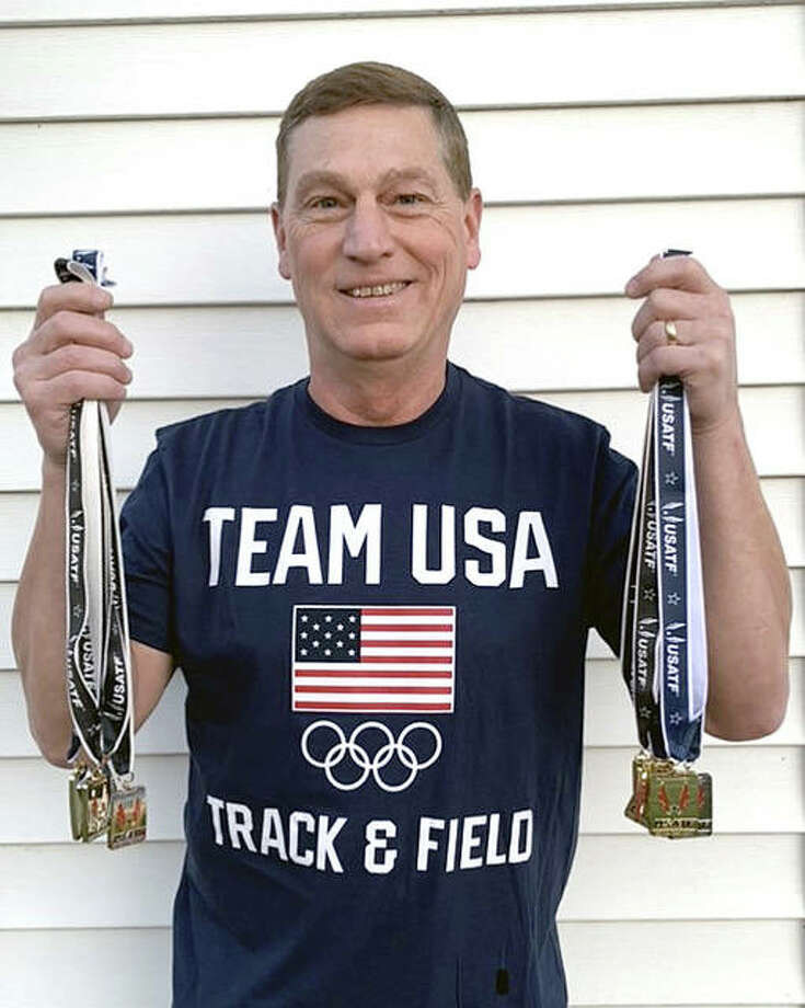 Senior athlete Mike young of Wood River displays the 10 medals he captured at the recent Illinois/Midwest Regional Masters Track and Field Meet in Romeoville. Photo: Submitted Photo