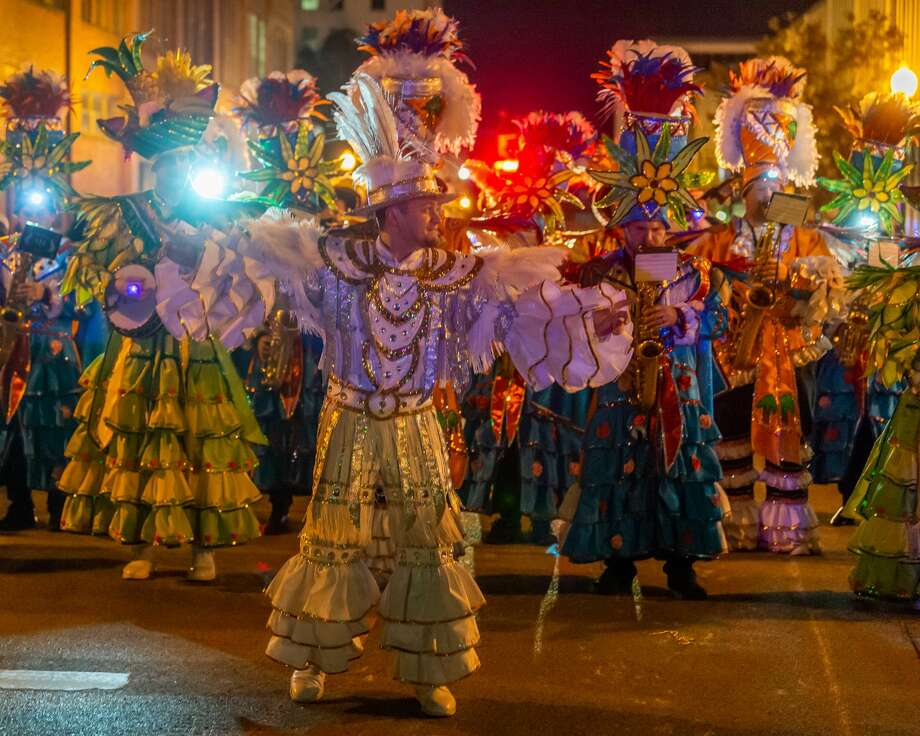 Day 2 of Mardi Gras in Southeast Texas lit up the night with the Krewe of Krewes Parade through downtown Beaumont, rides, food, music and fun on Friday, February 21, 2020. Fran Ruchalski/The Enterprise Photo: Fran Ruchalski/The Enterprise