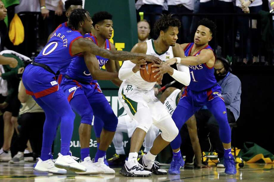 Kansas guard Marcus Garrett, left, and guard Devon Dotson, right, pressure Baylor forward Freddie Gillespie, center, during the first half of an NCAA college basketball game on Saturday, Feb. 22, 2020, in Waco, Texas. (AP Photo/Ray Carlin) Photo: Ray Carlin, Associated Press / Copyright 2020 The Associated Press. All rights reserved.