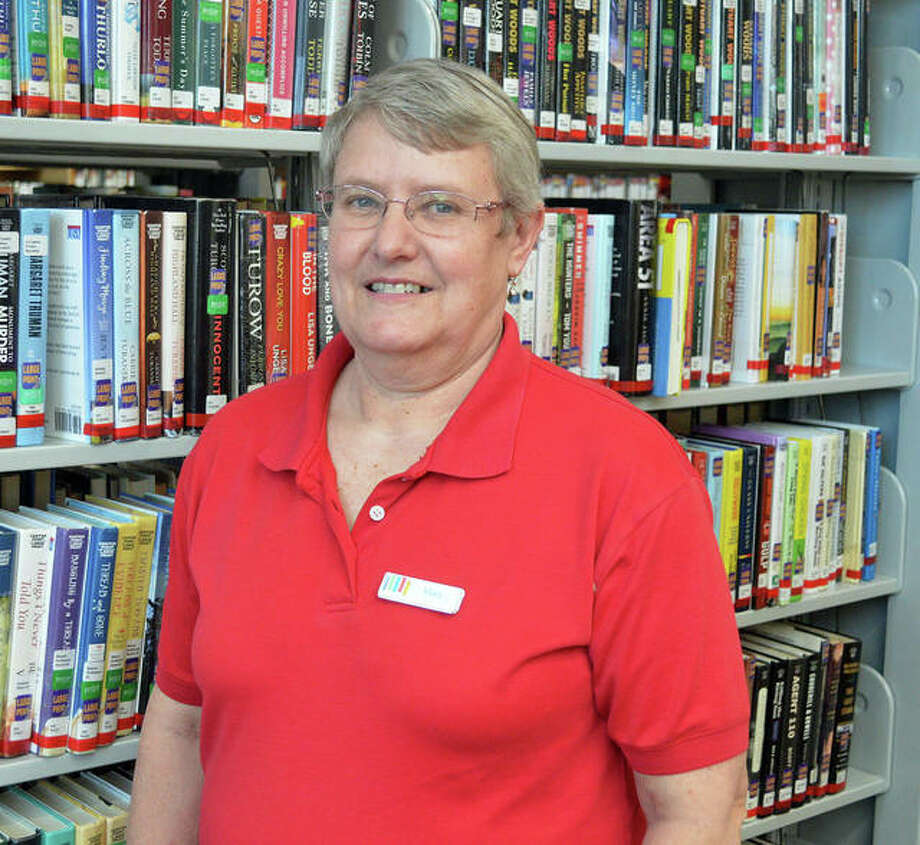Mary Westerhold poses for a photo at Edwardsville Public Library, where she currently works part-time. Westerhold recently retired from the Madison County Archival Library, where she had been the research manager since December 2000. Photo: For The Intelligencer