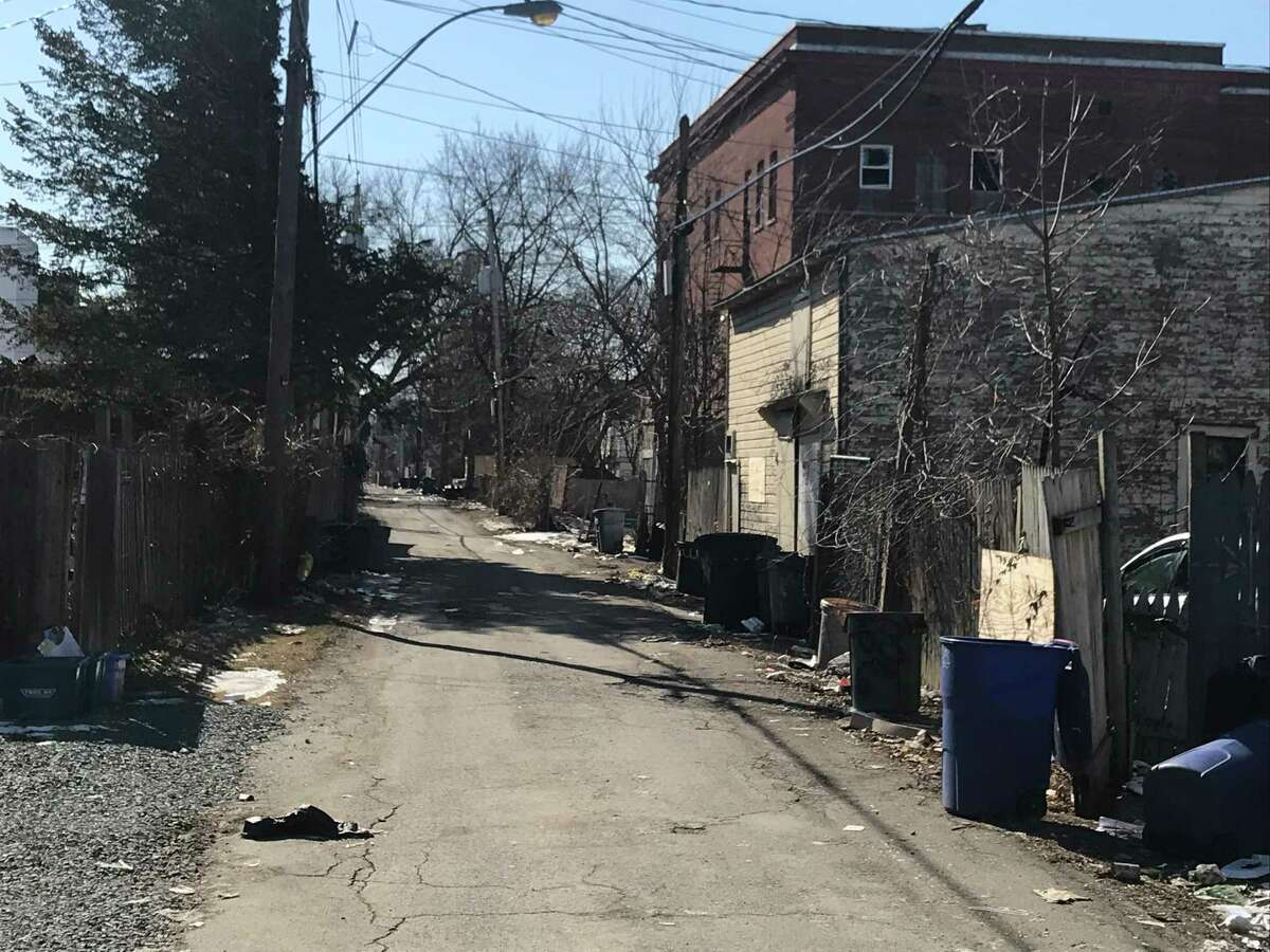 The Haskell School Alley has been the site of garbage problems in Troy, N.Y.
