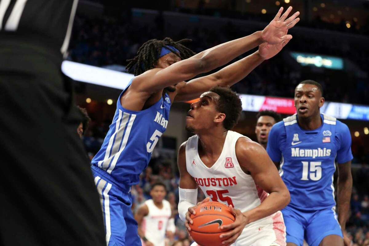 Houston forwards Fabian White Jr. (35) goes up for a shot as Memphis forward Precious Achiuwa (55) defends in the first half of an NCAA college basketball game Saturday, Feb. 22, 2020, in Memphis, Tenn. (AP Photo/Karen Pulfer Focht)
