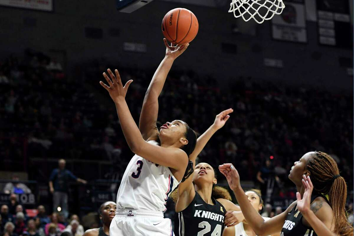 Connecticut's Megan Walker (3) shoots during the first half of an NCAA college basketball game against Central Florida Saturday, Feb. 22, 2020, in Storrs, Conn.
