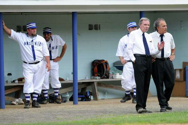 Former Ansonia High School Baseball Coaches James Finnucan and Mike Vacca stand outside the dugout of the Ansonia Coppermen during a vintage baseball game played at Nolan Field in 2014 as part of the city's 125th anniversary celebration.
