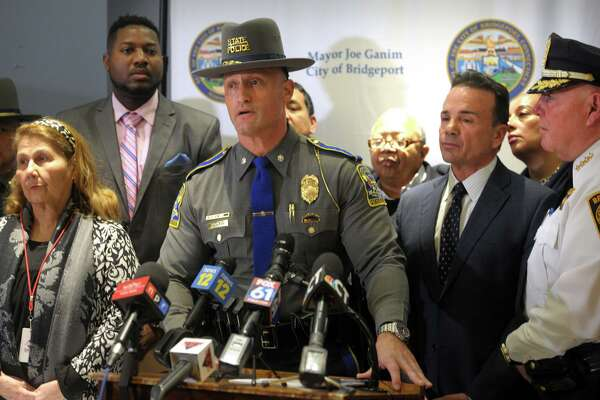 A state trooper speaks during Mayor Joe Ganim's news conference at the Morton Government Center where was joined by other elected and police officials to address violence prevention measures following several recent shooting incidents in Bridgeport, Conn. Jan. 28, 2020.