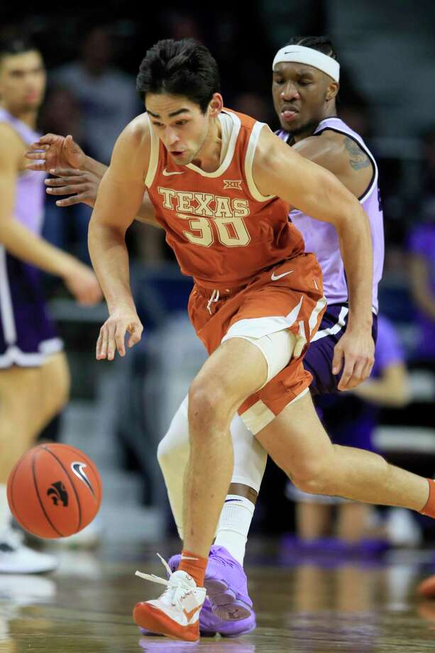 Texas forward Brock Cunningham (30) steals the ball in front of Kansas State forward Xavier Sneed, back, during the first half of an NCAA college basketball game in Manhattan, Kan., Saturday, Feb. 22, 2020. (AP Photo/Orlin Wagner) Photo: Orlin Wagner, Associated Press / Copyright 2020 The Associated Press. All rights reserved