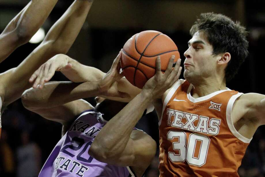 Kansas State forward Xavier Sneed (20) is fouled by Texas forward Brock Cunningham (30) during the second half of an NCAA college basketball game in Manhattan, Kan., Saturday, Feb. 22, 2020.  (AP Photo/Orlin Wagner) Photo: Orlin Wagner, Associated Press / Copyright 2020 The Associated Press. All rights reserved