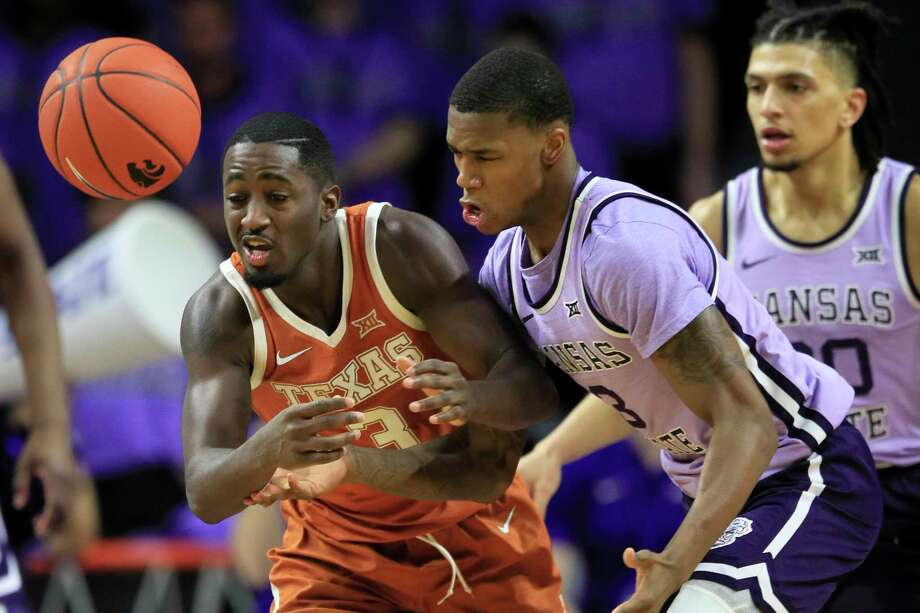 Texas guard Courtney Ramey, left, knocks the ball away from Kansas State guard DaJuan Gordon, right, during the second half of an NCAA college basketball game in Manhattan, Kan., Saturday, Feb. 22, 2020. (AP Photo/Orlin Wagner) Photo: Orlin Wagner, Associated Press / Copyright 2020 The Associated Press. All rights reserved