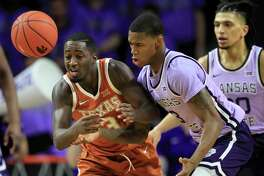 Texas guard Courtney Ramey, left, knocks the ball away from Kansas State guard DaJuan Gordon, right, during the second half of an NCAA college basketball game in Manhattan, Kan., Saturday, Feb. 22, 2020. (AP Photo/Orlin Wagner)