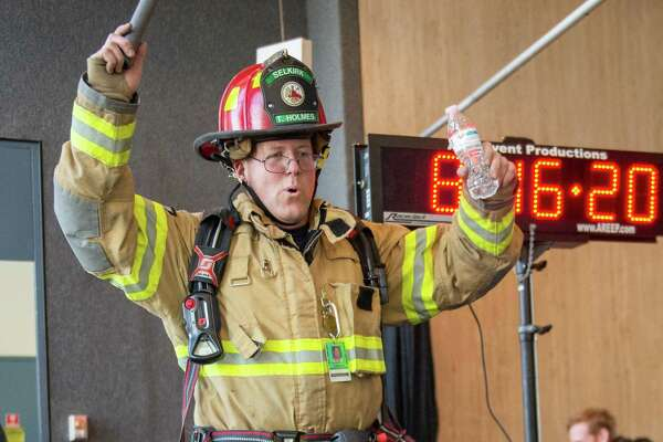 "Selkirk Firefighter Todd Holmes participates in the 32nd Annual CF Climb at the 42-floor Corning Tower in Albany NY on Saturday, Feb. 22 to benefit the Cystic Fibrosis Foundation a€?"" Northeastern New York Chapter (Jim Franco/Special to the Times Union.)"