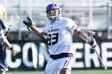 University at Albany's Ron John (33) celebrates his winning goal for a 14-13 win against Drexe during an NCAA lacrosse game Saturday, Feb. 22, 2020, in Albany, N.Y., Albany won