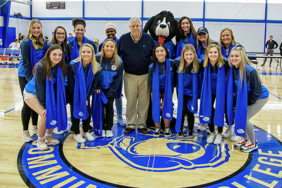 Members of the 2019 Lewis and Clark Community College women's soccer team, which advanced to the NJCAA Division I National Tournament and finished tied for third in the nation, was honored at Saturday's Blazer Day celebration at LCCC's River Bend Arena. The Trailblazers, who have won a pair of national women's soccer championships, have advanced to the NJCAA National tournament 10 times, more than any school in the nation during that time period. Above, the Trailblazers, including National Player of the Year Boitumelo Raballe (fourth from left, top row) and head coach Tim Rooney (center) pause after being introduced to a packed house during a women's/men's basketball twinbill.