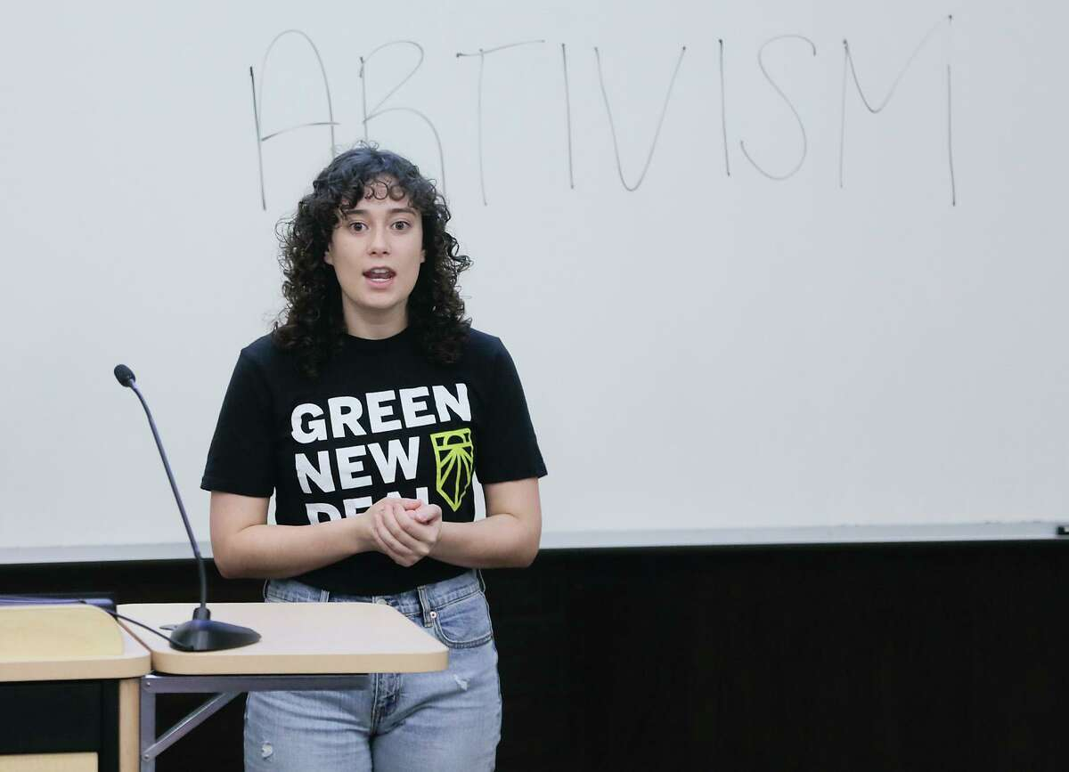 Sarah Greenberg of Houston gives a presentation on the Green New Deal during an event on climate change hosted by Mi Familia Vota, OCA-Greater Houston, JOLT Texas, Texas Rising, Coalition for Equity and Environment Resilience, and Sunrise Movement at Houston's Texas Southern University on Saturday, Feb. 22, 2020.