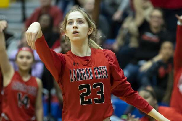 Langham Creek guard Kaley Perkins (23) and her teammates watch as she shoots a three pointer in a Region II-6A area girls basketball playoff against Oak Ridge high school during the second half at Klein high school, Friday, Feb. 21, 2020.