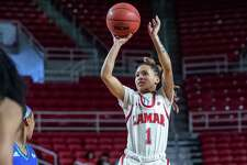 Jadyn Pimentel (1) puts up a shot from the top of the key in the second half as the Lady Cardinals of Lamar battled the Islanders of Texas A&M-Corpus Christi on Saturday, February 22, 2020. Fran Ruchalski/The Enterprise
