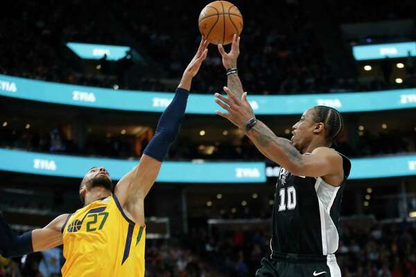 Utah Jazz center Rudy Gobert (27) blocks the shot of San Antonio Spurs forward DeMar DeRozan (10) during the first half of an NBA basketball game Friday, Feb. 21, 2020, in Salt Lake City. (AP Photo/Rick Bowmer)