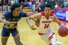 SIUE's Zeke Moore (14) drives against Chicago Carter Jr. of Murray State Saturday at the Vadalabene Center.Moore scored 10 points in SIUE's 59-58 loss.
