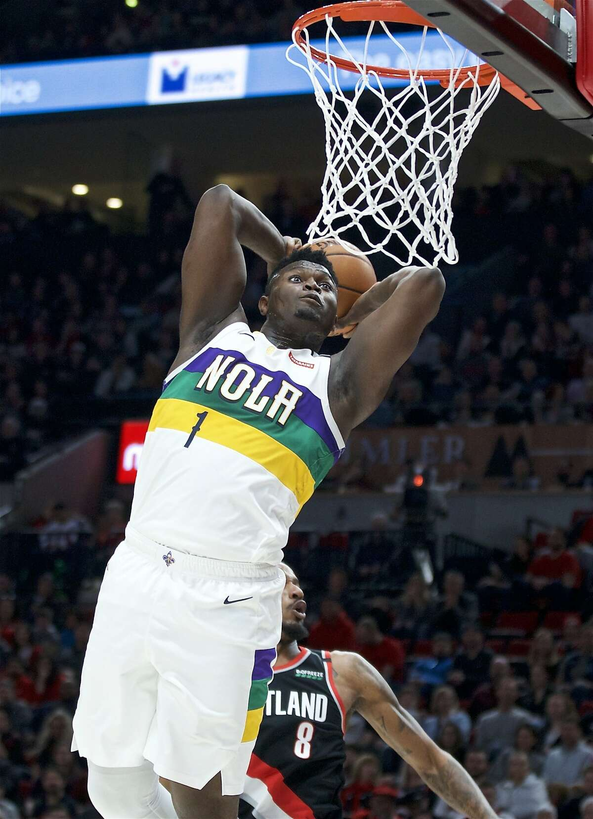 New Orleans Pelicans forward Zion Williamson goes up for a dunk in front of Portland Trail Blazers forward Trevor Ariza during the first half of an NBA basketball game in Portland, Ore., Friday, Feb. 21, 2020. (AP Photo/Craig Mitchelldyer)