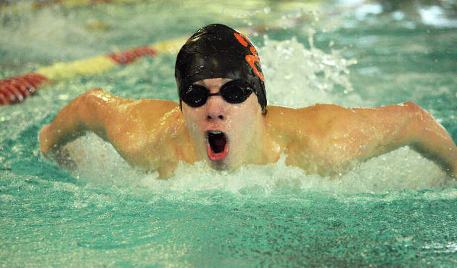 Edwardsville's Logan Mills swims in the 100-yard butterfly during Saturday's Sacred Heart-Griffin Sectional at Eisenhower Pool in Springfield. Mills took first place and qualified for the state meet, Feb. 28-29 at Evanston High School. Photo: Scott Marion/The Intelligencer