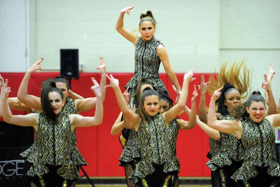 Fairfield Warde's Meg Hios, top, performs with her team in the exhibit category during the 5th annual Dance Jam Competition at Fairfield Warde High School in Fairfield, Conn., on Saturday Feb. 22, 2020. Photo: Christian Abraham / Hearst Connecticut Media / Connecticut Post