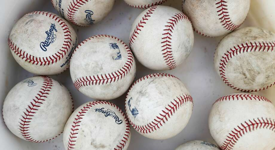 Scuffed up baseballs in a bucket during spring training at the Fitteam Ballpark of The Palm Beaches, in West Palm Beach, Saturday, Feb. 22, 2020. Photo: Karen Warren/Staff Photographer