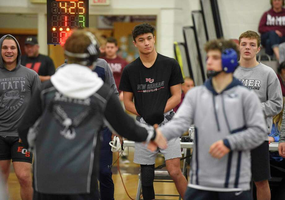New Canaan's Tyler Sung, center, waits to be introduced. He will wrestle Xavier's Quinn Moynihan in the 152 pound weight class finals of the CIAC Class L Wrestling tournament on Feb. 22, 2020 at Bristol Central High School in Bristol, Connecticut. Photo: Matthew Brown / Hearst Connecticut Media / Stamford Advocate