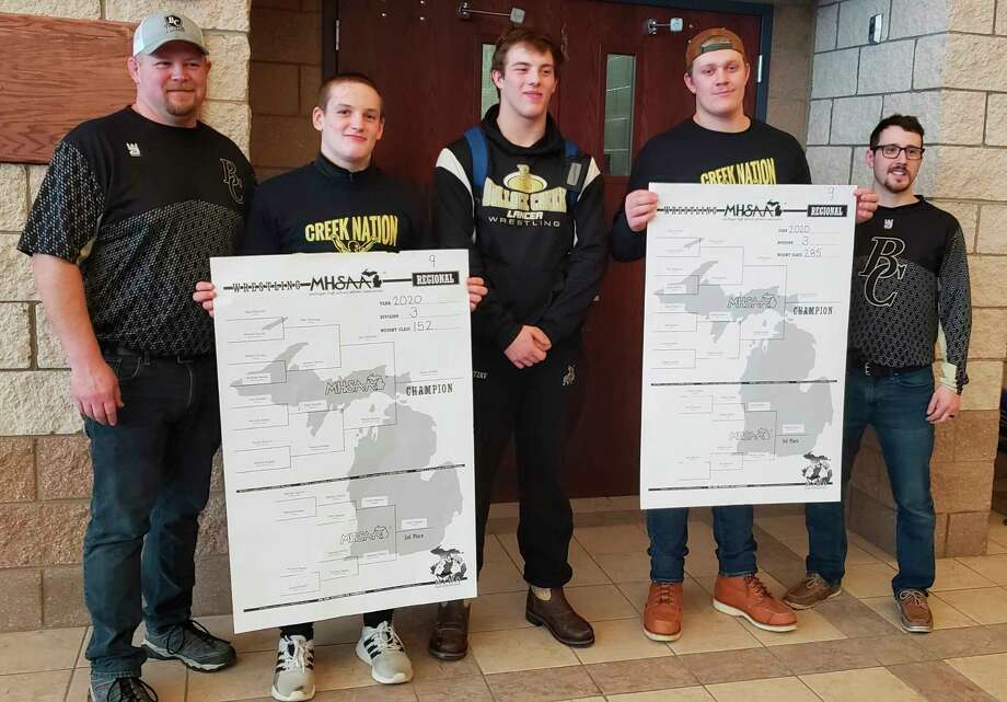 Pictured, from left, are Bullock Creek wrestling coach Alan Curtis, Lancers' state qualifiers Peyton Brooks (regional champion), Tyler Kutzke and Clayton Hackett (regional champion); and assistant coach Andy Brown.