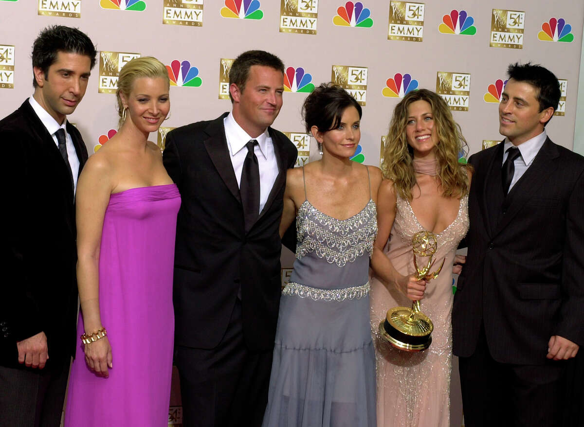 """FILE - In this Sept. 22, 2002 file photo, the stars of """"Friends,"""" from left, David Schwimmer, Lisa Kudrow, Matthew Perry, Courteney Cox Arquette, Jennifer Aniston and Matt LeBlanc pose with the award for outstanding comedy series at the 54th annual Primetime Emmy Awards in Los Angeles. WarnerMedia announced Friday that the entire original cast of """"Friends"""" will reunite for an unscripted special that will be available on HBO Max when the service debuts in May. (AP Photo/Reed Saxon, file)"""