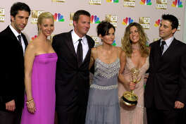 "FILE - In this Sept. 22, 2002 file photo, the stars of ""Friends,"" from left, David Schwimmer, Lisa Kudrow, Matthew Perry, Courteney Cox Arquette, Jennifer Aniston and Matt LeBlanc pose with the award for outstanding comedy series at the 54th annual Primetime Emmy Awards in Los Angeles. WarnerMedia announced Friday that the entire original cast of ""Friends"" will reunite for an unscripted special that will be available on HBO Max when the service debuts in May. (AP Photo/Reed Saxon, file)"