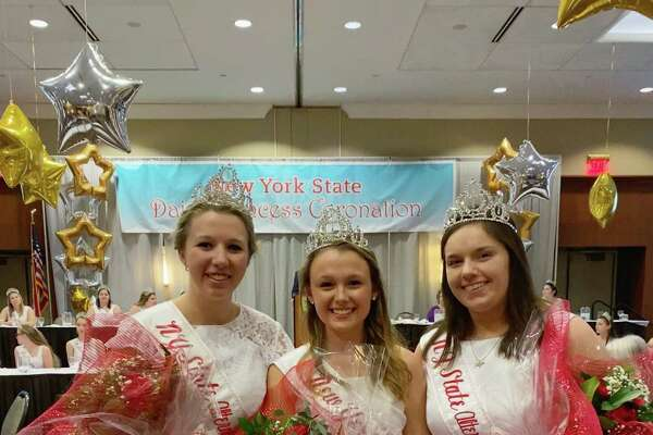 Washington County Dairy Princess Erin Armitage, left, was named the second alternate state Dairy Princess and will spend another year promoting the industry, now on a statewide level. In addition to Armitage, Delilah Hoag, the Rensselear County Dairy Princess was recognized during the product knowledge portion of the pageant and received a $100 scholarship. Armitage is shown here with New York State Dairy Princess Natalie Vernon from Wayne County, and 1st Alternate Princess Rachel Rouland from Monroe County. The pageant was Feb. 18 in Liverpool. (Greg Szklany)