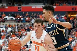 SYRACUSE, NY - FEBRUARY 22: Syracuse Orange Guard Joseph Girard III (11) dribbles the ball against Georgia Tech Yellow Jackets Guard Michael Devoe (0) during the first half of the College Basketball game between the Georgia Tech Yellow Jackets and the Syracuse Orange on February 22, 2020, at the Carrier Dome in Syracuse, NY. (Photo by Gregory Fisher/Icon Sportswire via Getty Images)