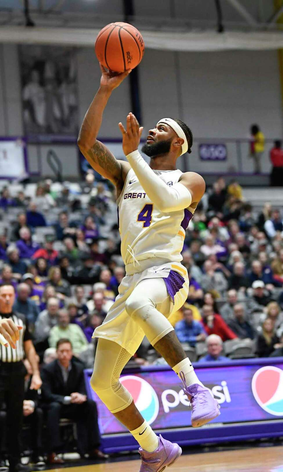 University at Albany guard Ahmad Clark (4) scores against New Hampshire during the first half of an NCAA basketball game Saturday, Feb. 22, 2020, in Albany, N.Y., (Hans Pennink / Special to the Times Union)