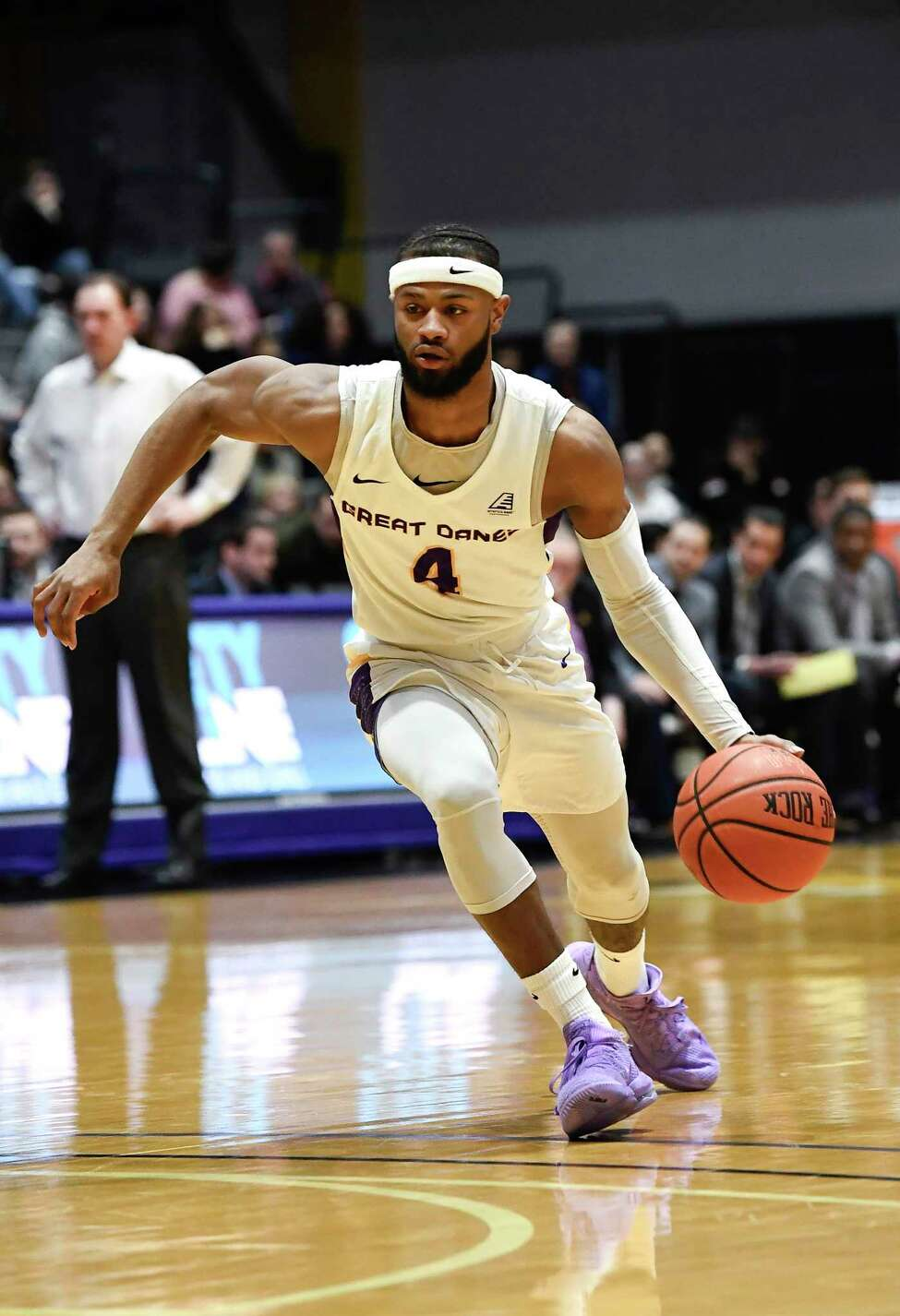 University at Albany guard Ahmad Clark (4) moves the ball against New Hampshire during the first half of an NCAA basketball game Saturday, Feb. 22, 2020, in Albany, N.Y., (Hans Pennink / Special to the Times Union)