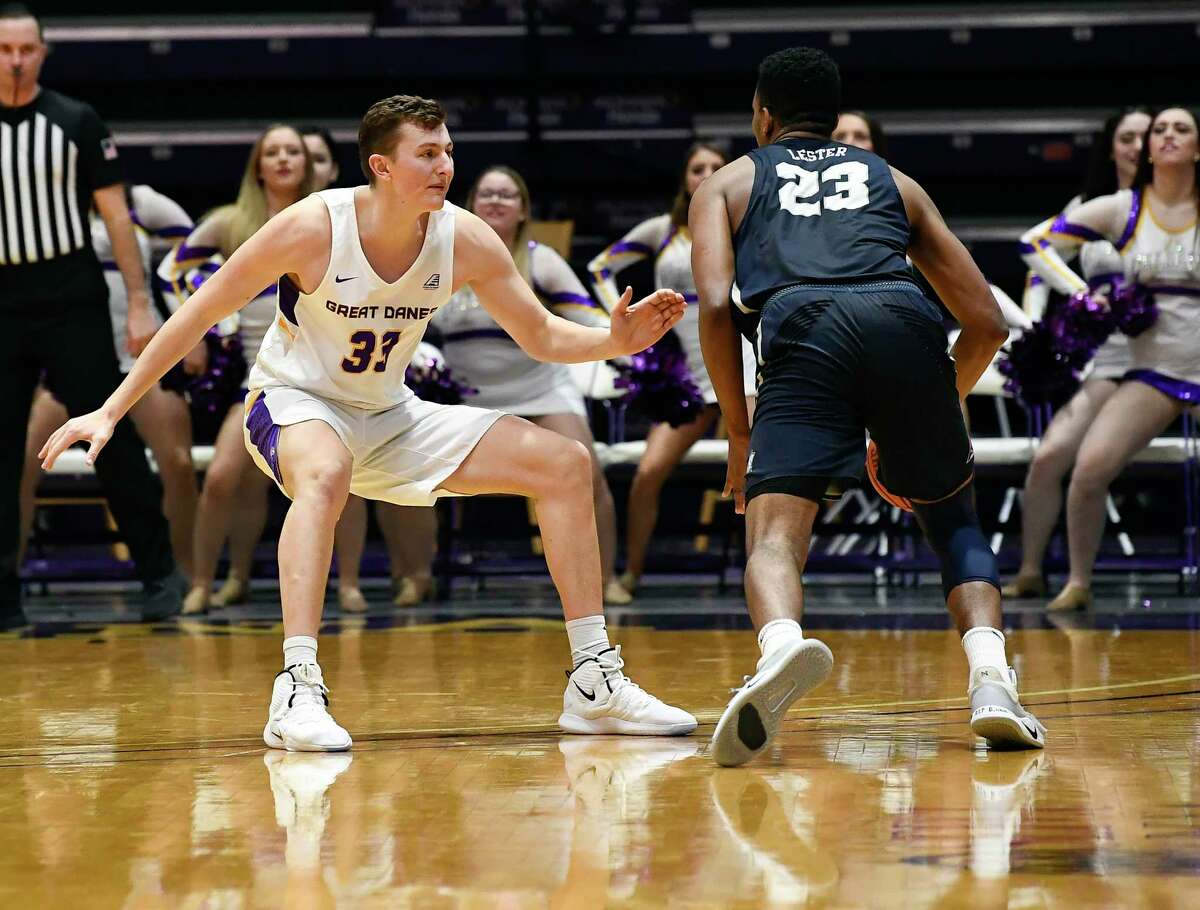 University at Albany forward Sasha French (33) defends against New Hampshire forward Chris Lester (23) during the first half of an NCAA basketball game Saturday, Feb. 22, 2020, in Albany, N.Y., (Hans Pennink / Special to the Times Union)