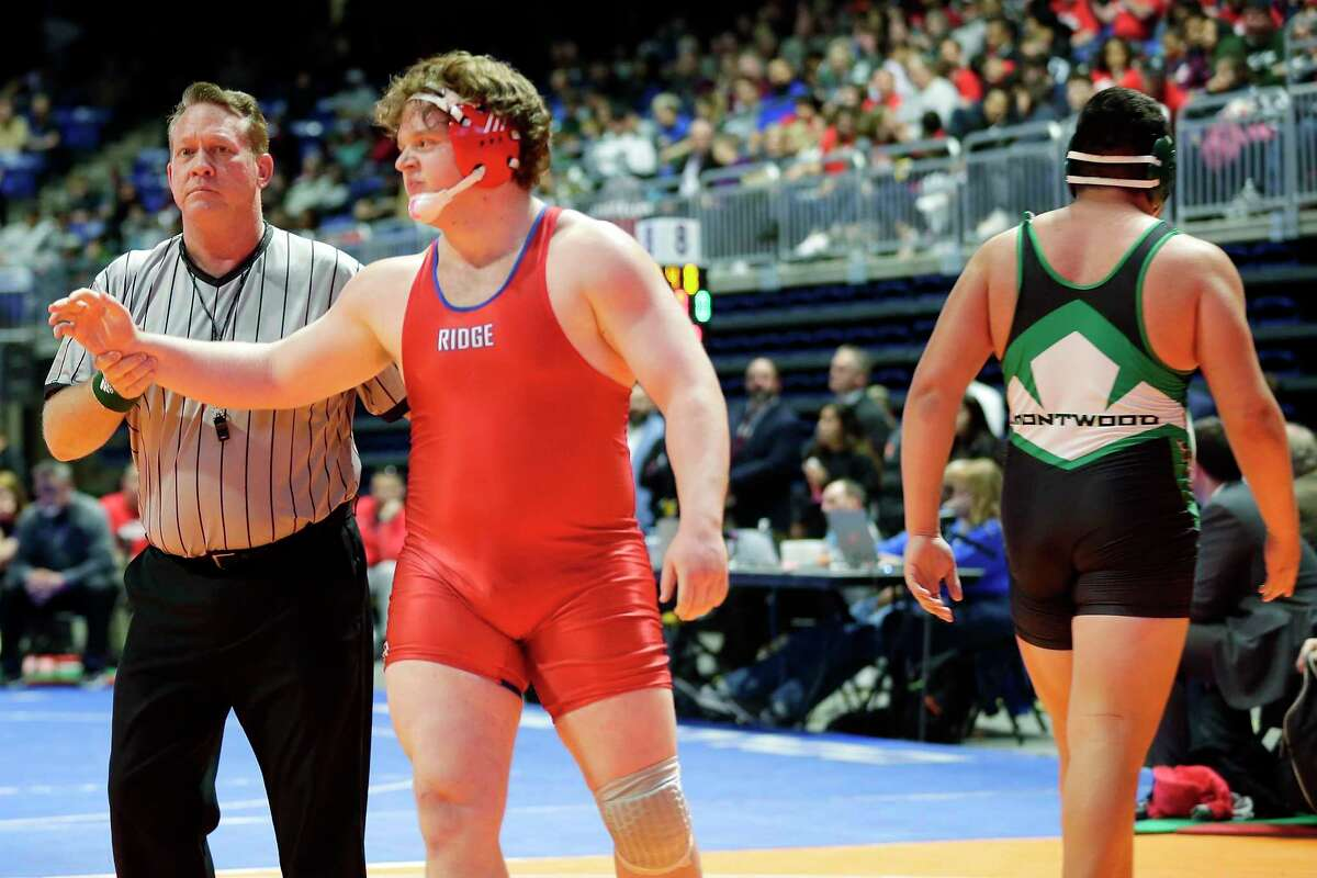 Oak Ridge's Brennan McElroy, left, is named the winner as Montwood's Ivan Escobar, right, walks away after their 5th round Class 6A-285lbs match of the state high school wrestling championships Saturday, Feb. 22, 2020 at the Berry Center in Cypress, TX.