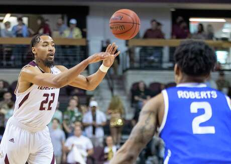 San Marcos, TX; Texas State Bobcats guard Nijal Pearson (22)passes off the ball against the Georgia State Panthers during the first half at the NCAA mens basketball game on Saturday, Feb 12, 2020, at the Strahan Arena. [JOHN GUTIERREZ/FOR EXPRESS-NEWS]
