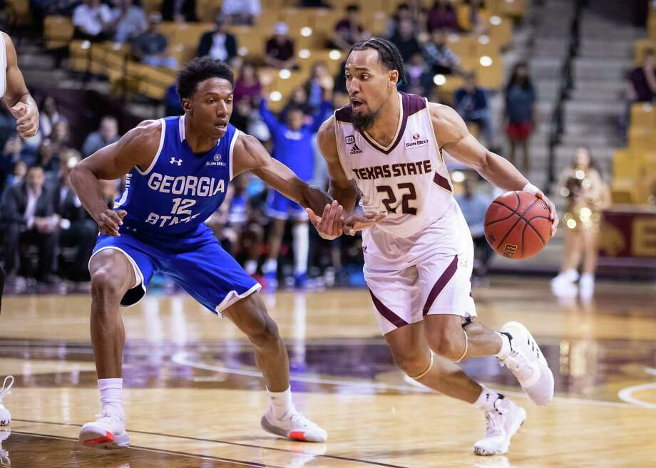 San Marcos, TX; Texas State Bobcats guard Nijal Pearson (22) dribbles the ball as Georgia State Panthers guard Kane Williams (12) defends during the second half at the NCAA mens basketball game on Saturday, Feb 12, 2020, at the Strahan Arena. [JOHN GUTIERREZ/FOR EXPRESS-NEWS] Photo: John Gutierrez, Photographer / John Gutierrez / John Gutierrez