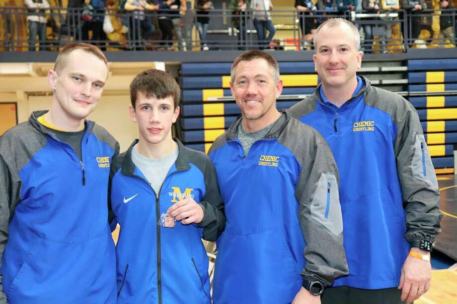 Midland High wrestlerConnor Schelb, second from left, is shown with his coaches on Saturday after qualifying for state for the first time.