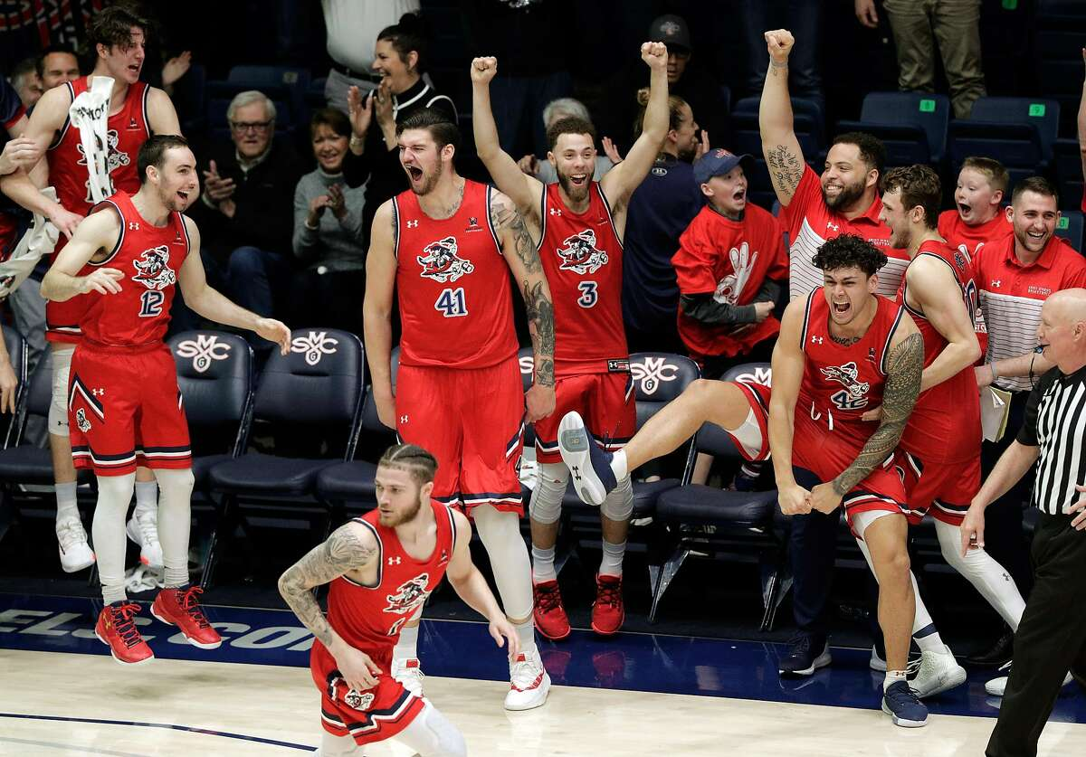 The Gaels' bench erupts as Dan Sheets (15) hits a basket for the final, and his only, points of the game late in the second half as the St. Mary's Gaels played the University of San Diego Toreros at McKeon Pavilion in the Gael's final home game in Moraga, Calif., on Saturday, February 22, 2020.