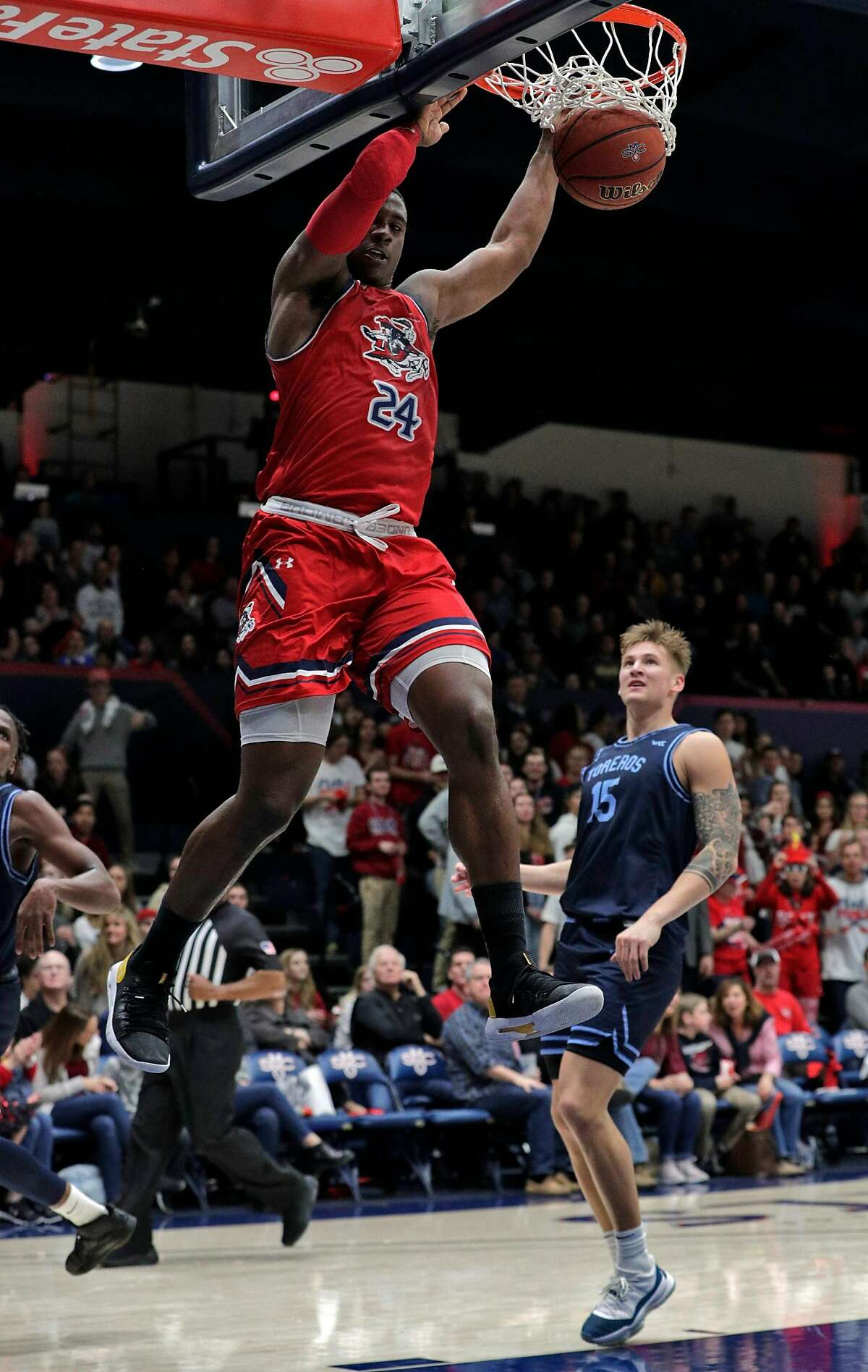 Malik Fitts (24) dunks the ball in the first half as the St. Mary's Gaels played the University of San Diego Toreros at McKeon Pavilion in the Gael's final home game in Moraga, Calif., on Saturday, February 22, 2020.