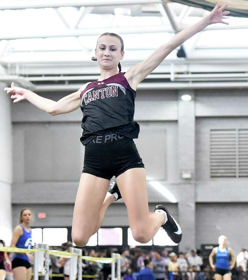 New Haven Connecticut - February 22, 2020: Chelsea Mitchell of Canton H.S. wins the girls long jump during the CIAC State Open Indoor Track Championship Saturday at the Floyd Little Athletic Center in New Haven. Photo: Peter Hvizdak / Hearst Connecticut Media / New Haven Register