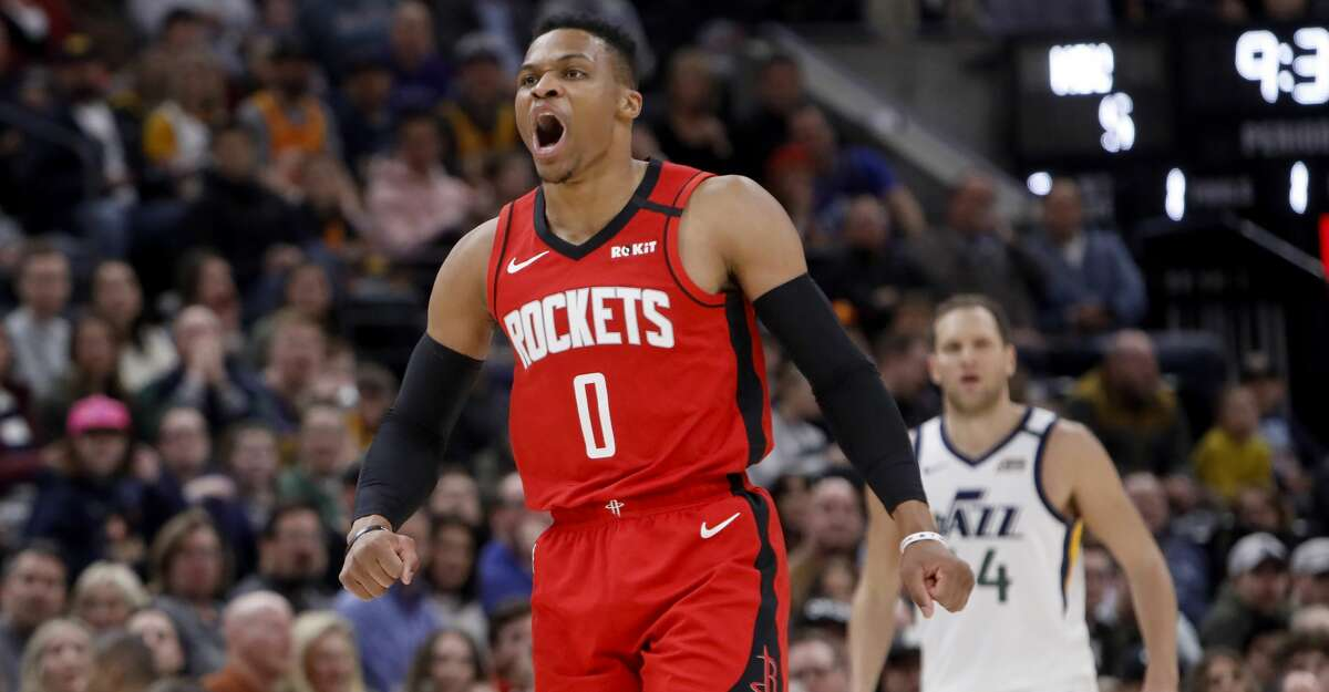 Houston Rockets' Russell Westbrook (0) reacts to scoring a basket off a rebound during the first half of the team's NBA basketball game against the Utah Jazz on Saturday, Feb. 22, 2020, in Salt Lake City. (AP Photo/Kim Raff)